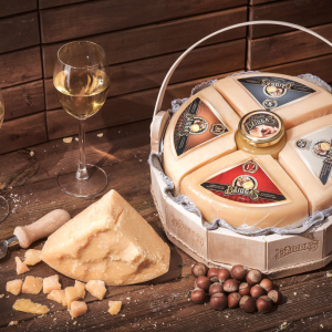 Hard cheese DŽIUGAS, ripened for 12, 24, 36 and 48 months, and honey in a large basket